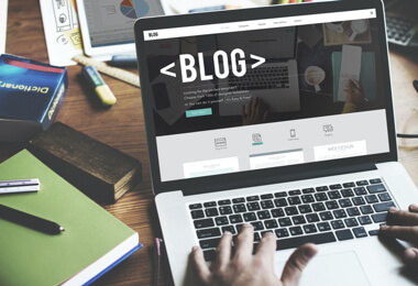 "a laptop screen showing ""blog"""